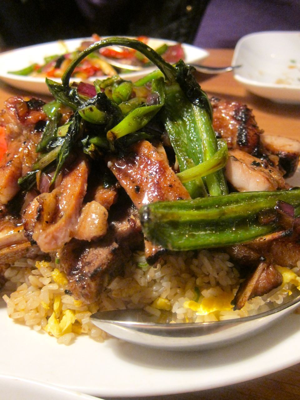 A Red Farm zealot singles out the lemongrass grilled pork chops as uptown's triumph.