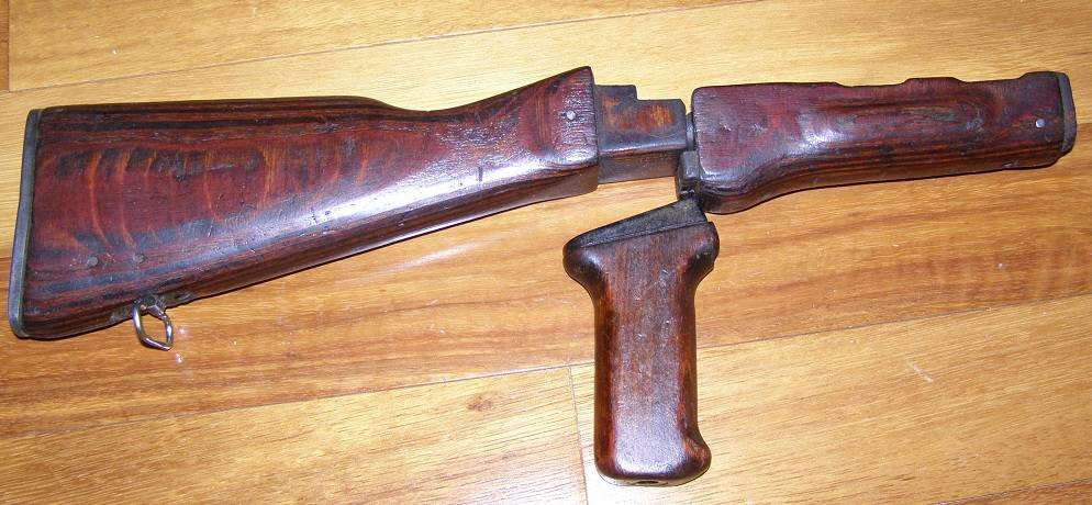 An example of late style Romanian wood   seen on WASR and AIM74 rifles   Very little grain and lighter finish. Don t care for Donkey Dong